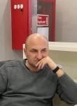 Irakli, 53  , Tbilisi