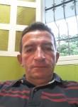 John, 57  , Bogota