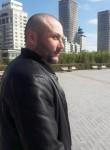Andrey Belyaev , 33  , Qaraton