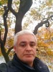 Mustafa, 47  , Paris