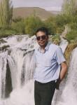 Özcan, 35  , Turki
