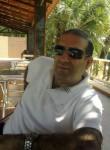 Marwan, 55  , Luanda