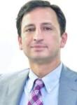 Dinesh Sharman, 55  , Abu Dhabi