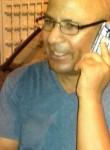 Majid, 54  , Tunis