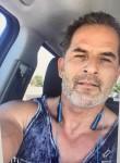 Tmarelli, 56, Layton