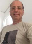 Maxwell James, 55, Budapest