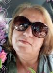 marie, 57  , Paris