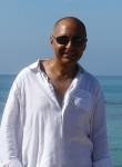 Pierre Larusso, 52  , Cancun