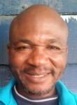 Michel Olinga, 49  , Douala