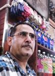 Hassan , 41  , New York City