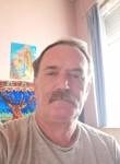 Ioan Sarmasan , 51  , Brussels