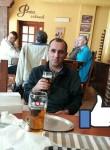 Roman, 40  , Reda