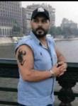 Hassan, 41, Cairo