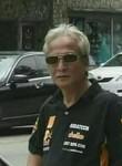 Tobana Tobing, 52, Jakarta