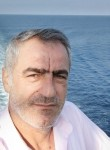 Turan, 51, Ankara