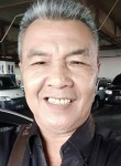Masril, 47  , Jakarta