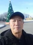 Guan jianxin, 65  , Almaty
