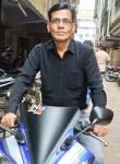 Sureshbhai, 45  , Surat