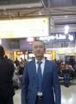 Tolegen, 37  , Astana