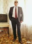 ilham, 56  , Ganja