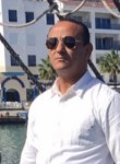 Muner, 39  , Tripoli