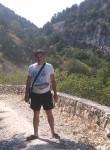 Roman, 38  , Torez