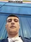 Komil , 33  , Saint Petersburg